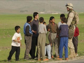 US Soldier with Iraqi Kids