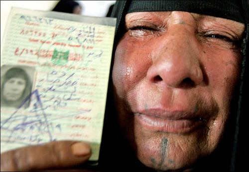 Iraqi woman weeps